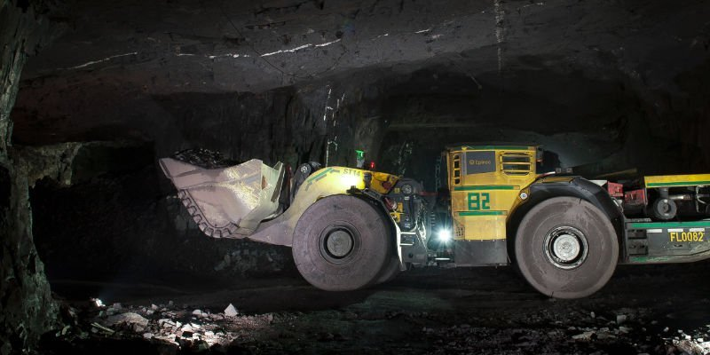 earth movers digging in a coal mine